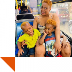 Young mother with two sons on a bus